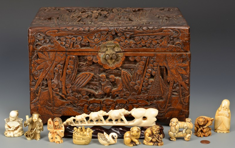 Lot 4010108: Ivory netsukes in camphorwood chest, 12 items total
