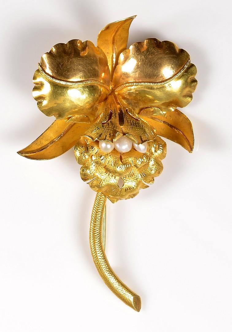 Lot 372: 18K Orchid Brooch, 39.6 Grams