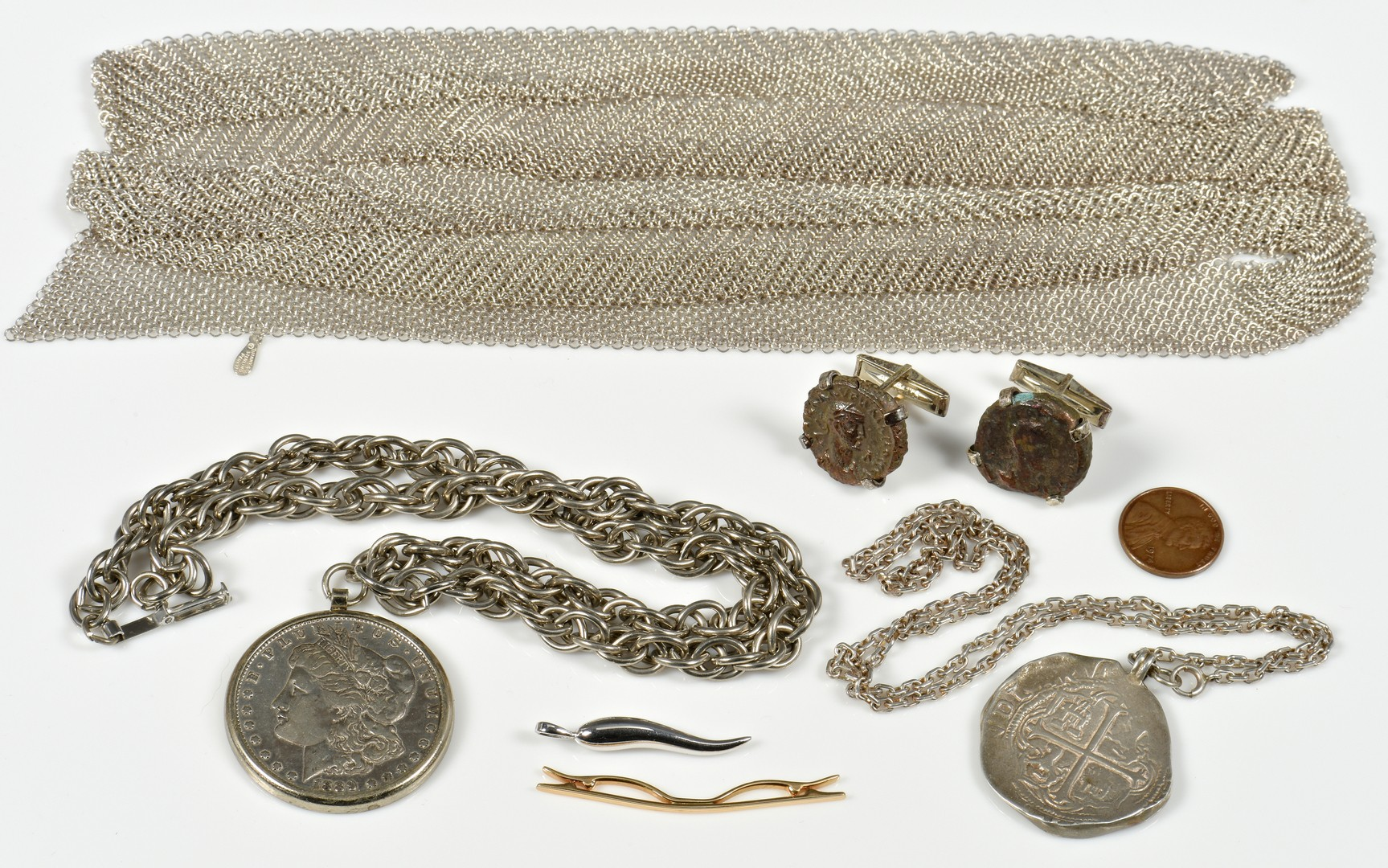 Lot 383: Tiffany Jewelry with coin items