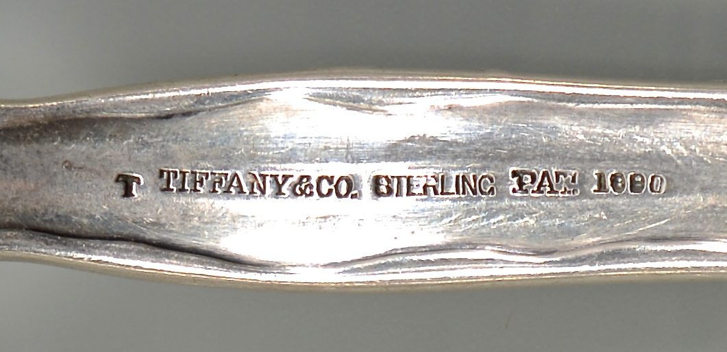 Lot 55: Tiffany Lap Over Edge Silver Forks, 9
