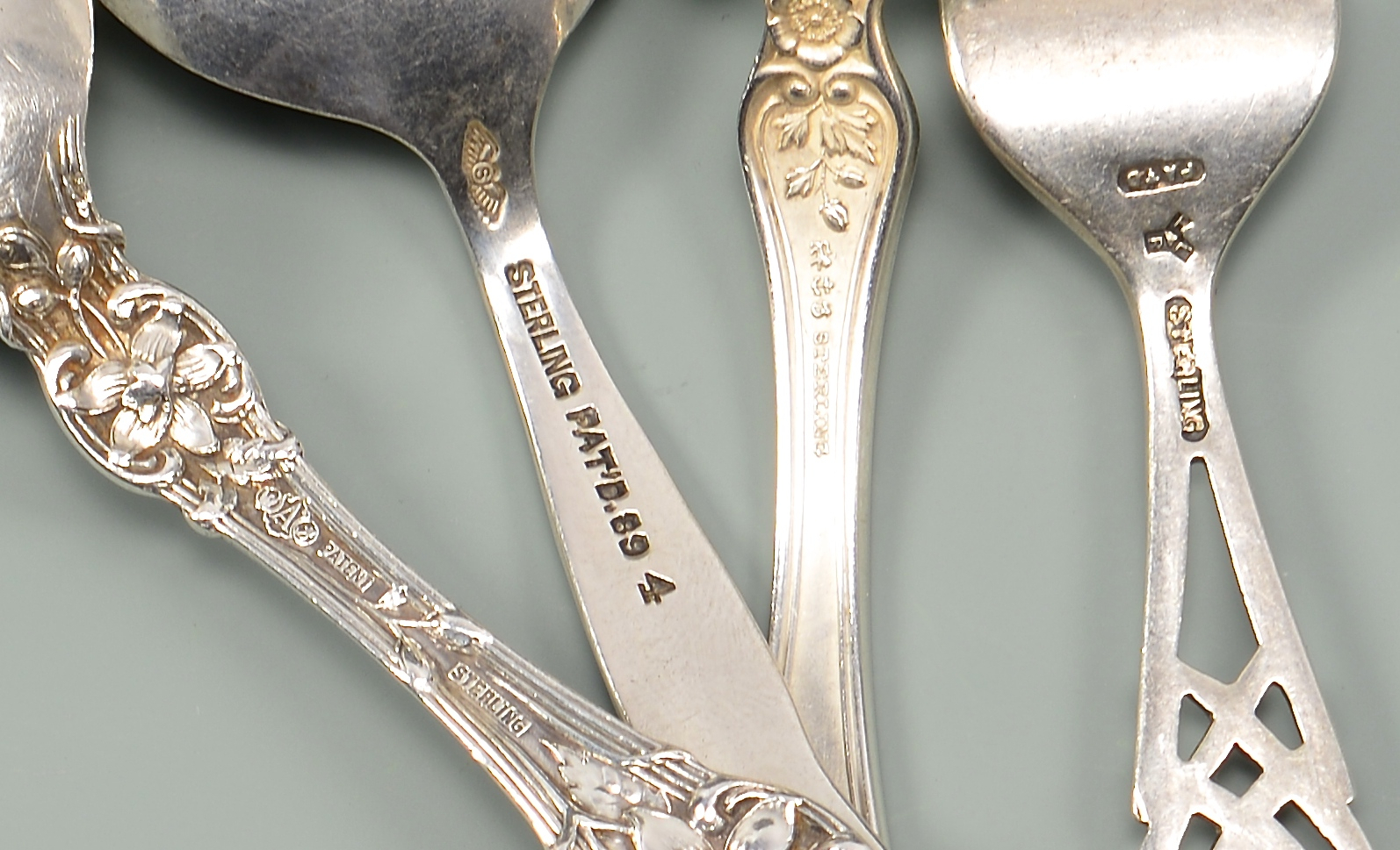 Lot 56: Tiffany Lap Edge Serving Spoon plus other sterling