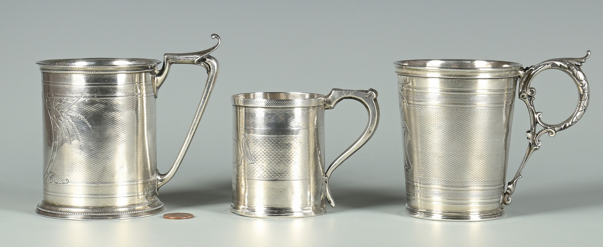 Lot 61: 3 Coin Silver Mugs