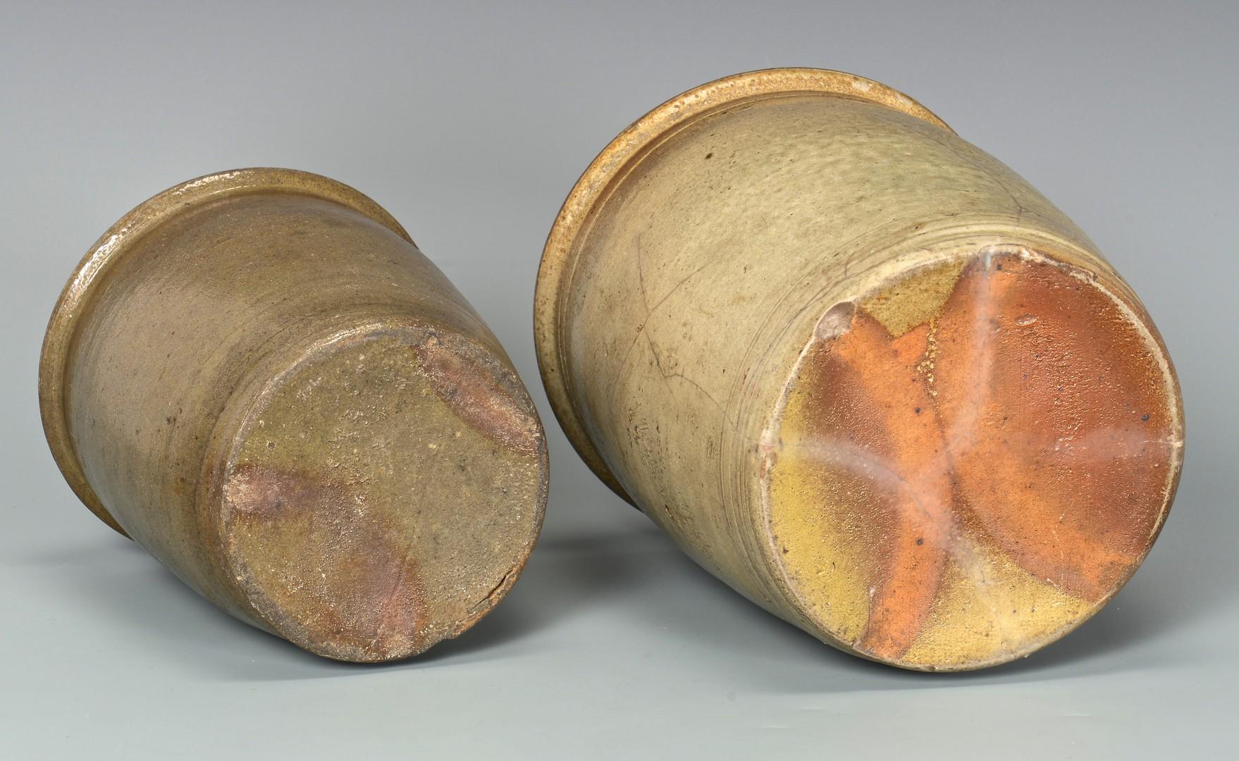 Lot 693: 2 East TN M.P. Harmon Stoneware Jars, 1 upside dow