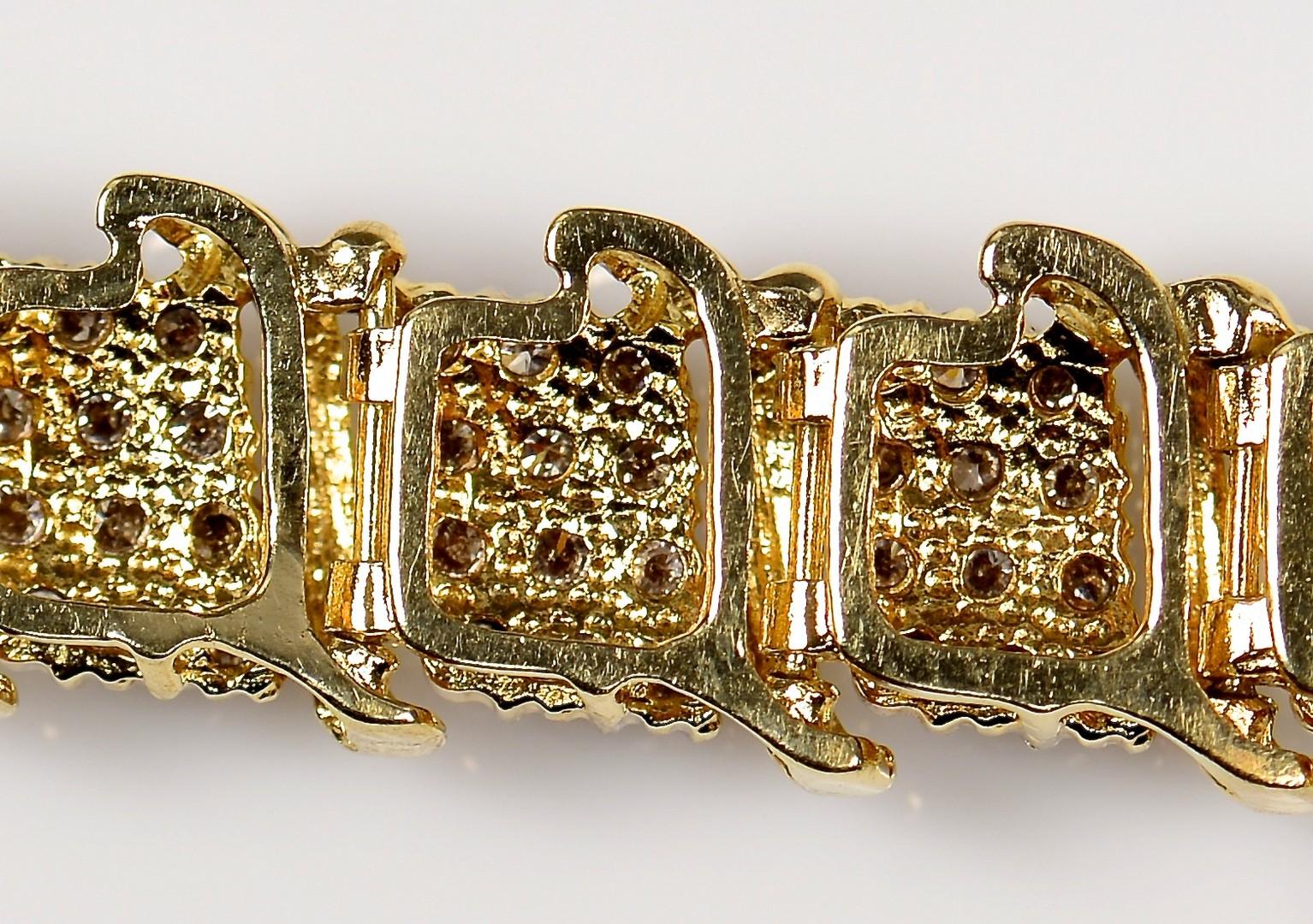 Lot 70: Two 10K Diamond Link Bracelets