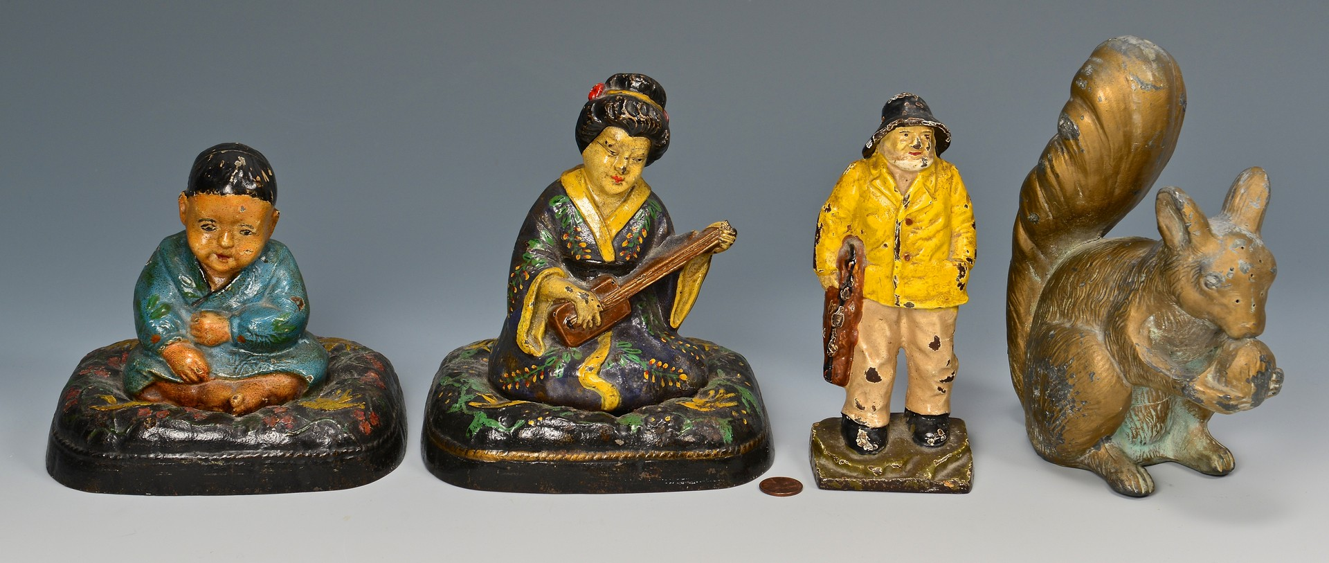 Lot 800: Three Cast Iron Doorstops & One Gardening Figural