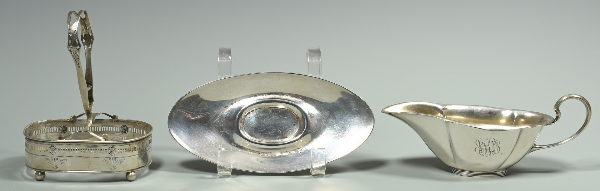 Lot 872: Sterling bread trays, sauce boat and flatware