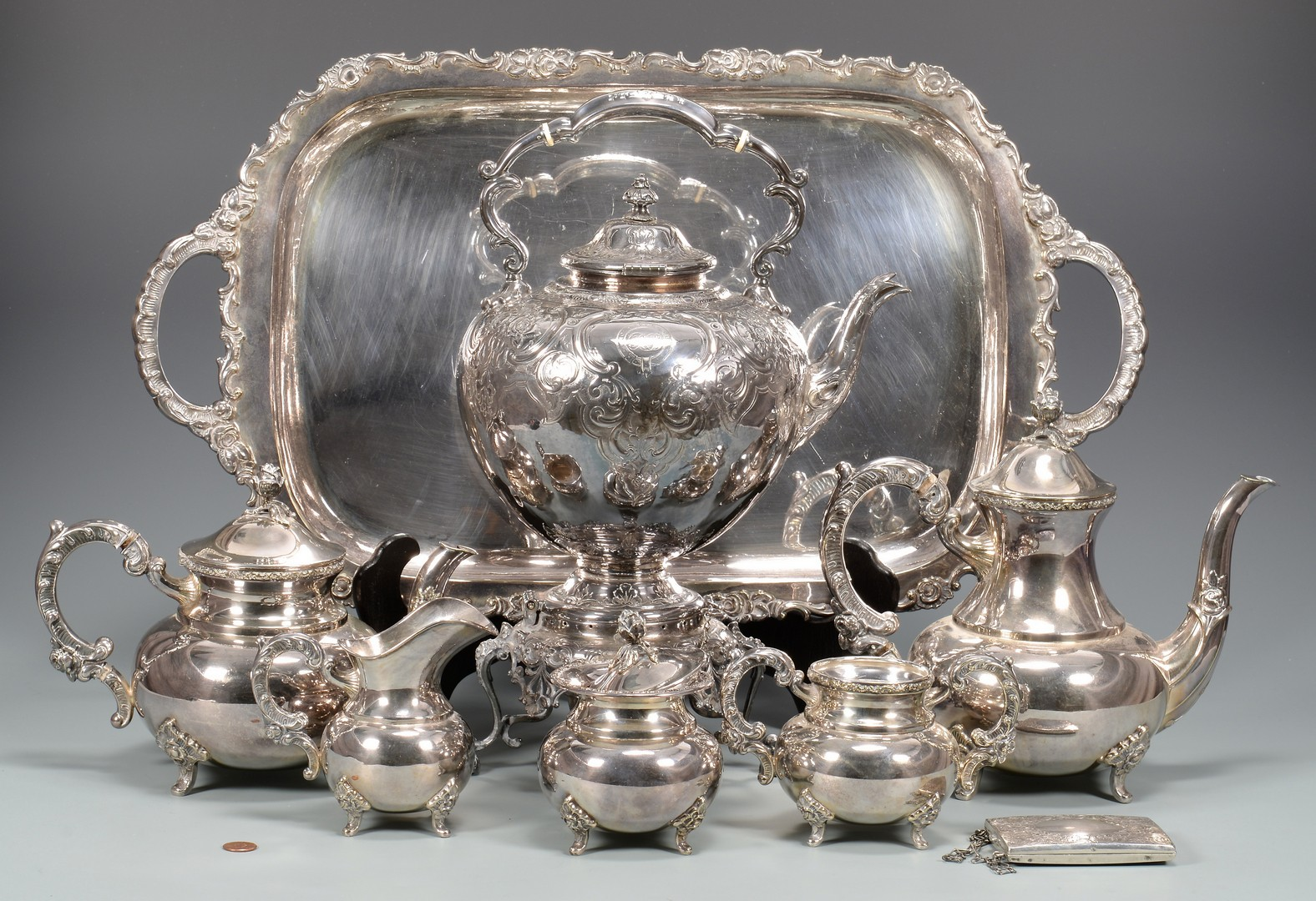 Lot 892: Tea service, kettle and purse