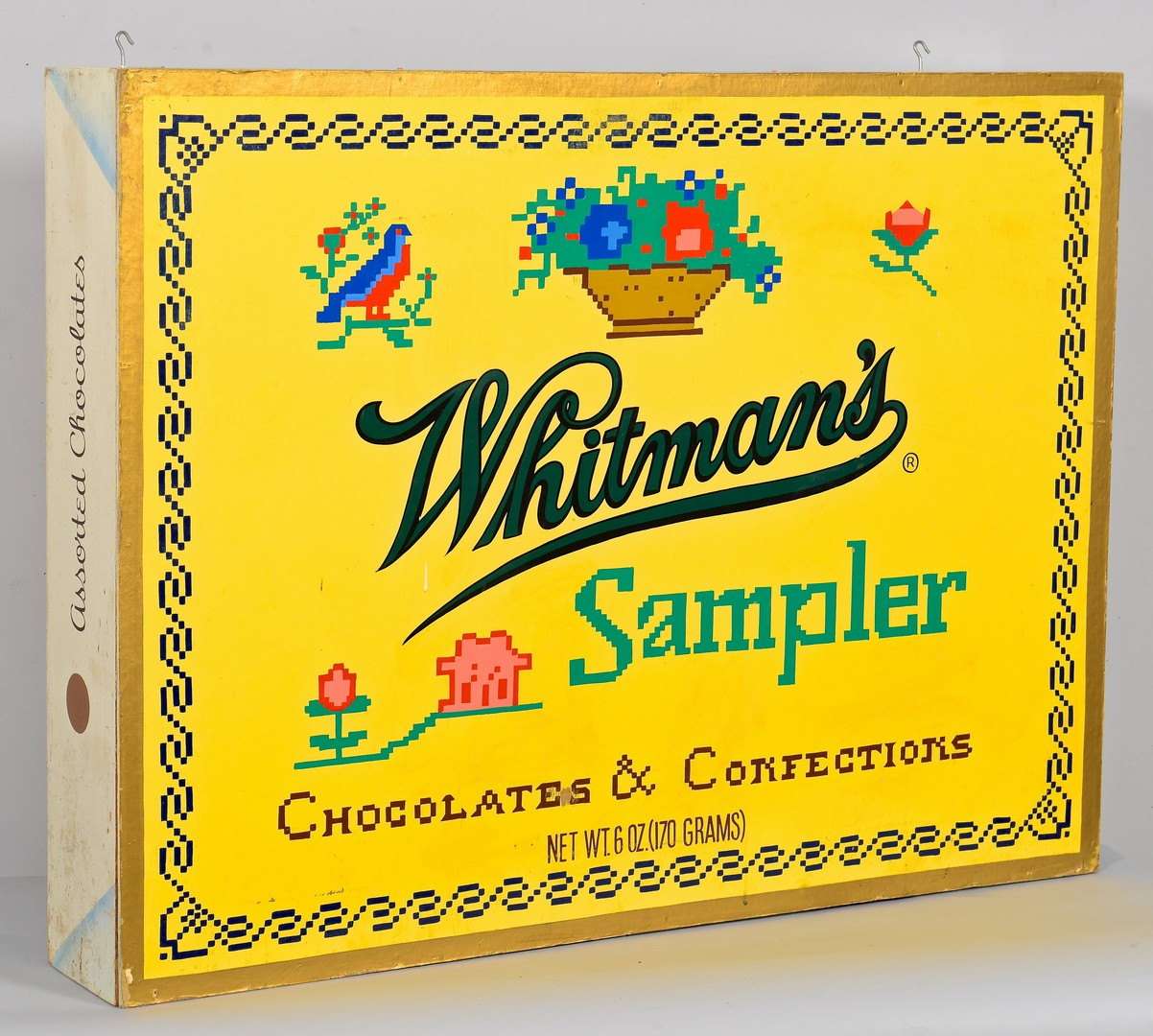 Lot 895: Whitman-Stover Candy Advertising Sign