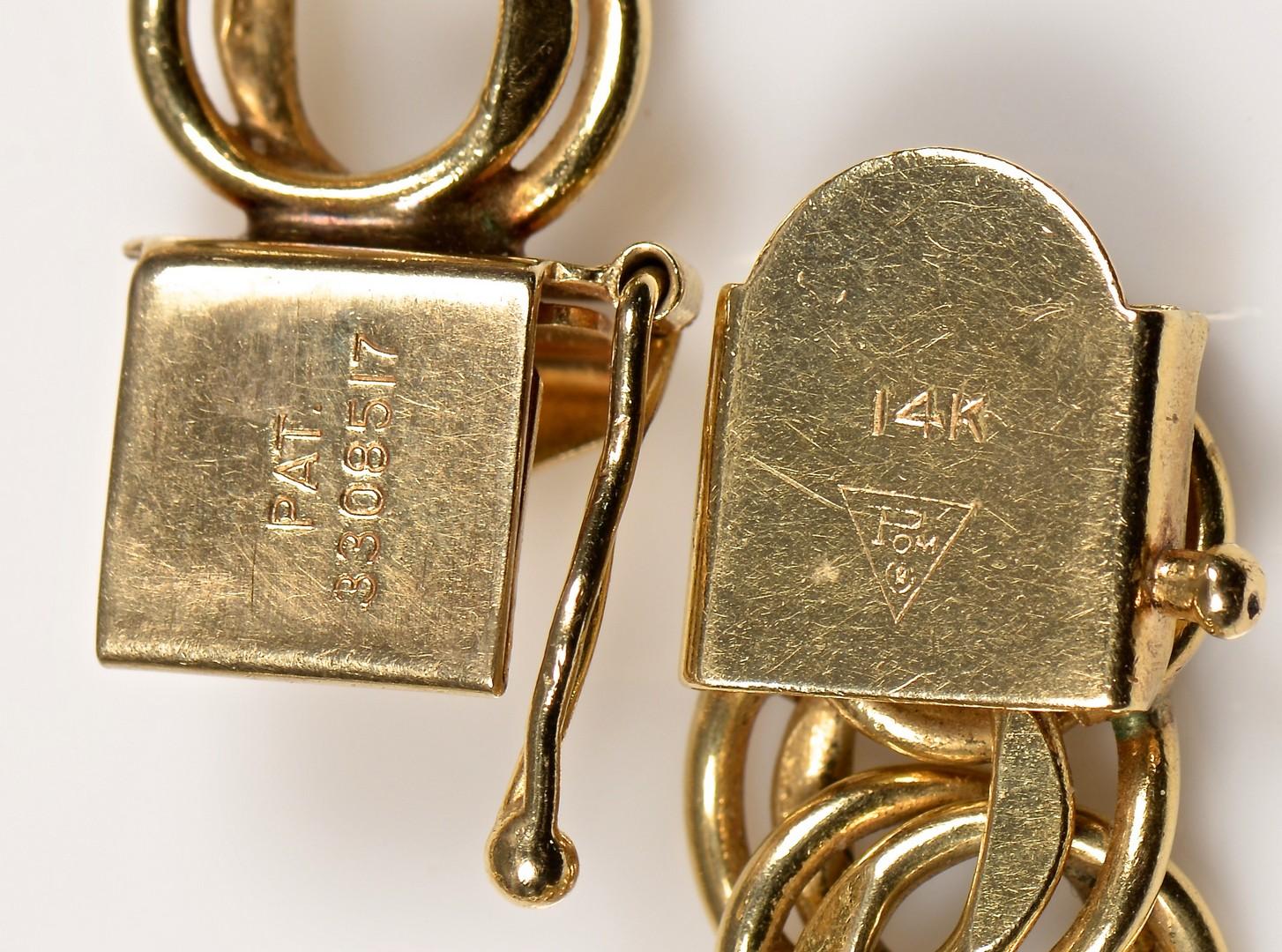 Lot 940: 14K Charm Bracelet w/ Heart Charm