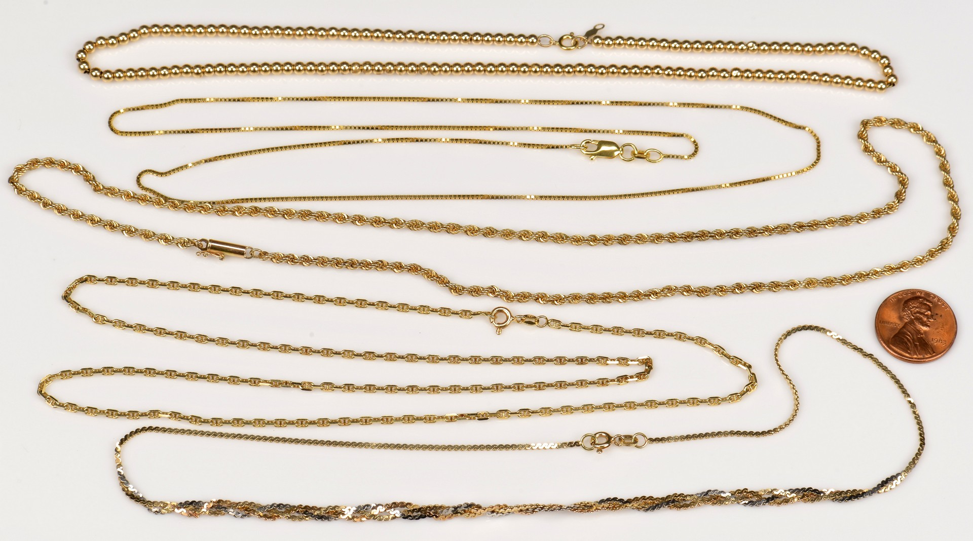 Lot 941: Group of 5 14K Gold Chains