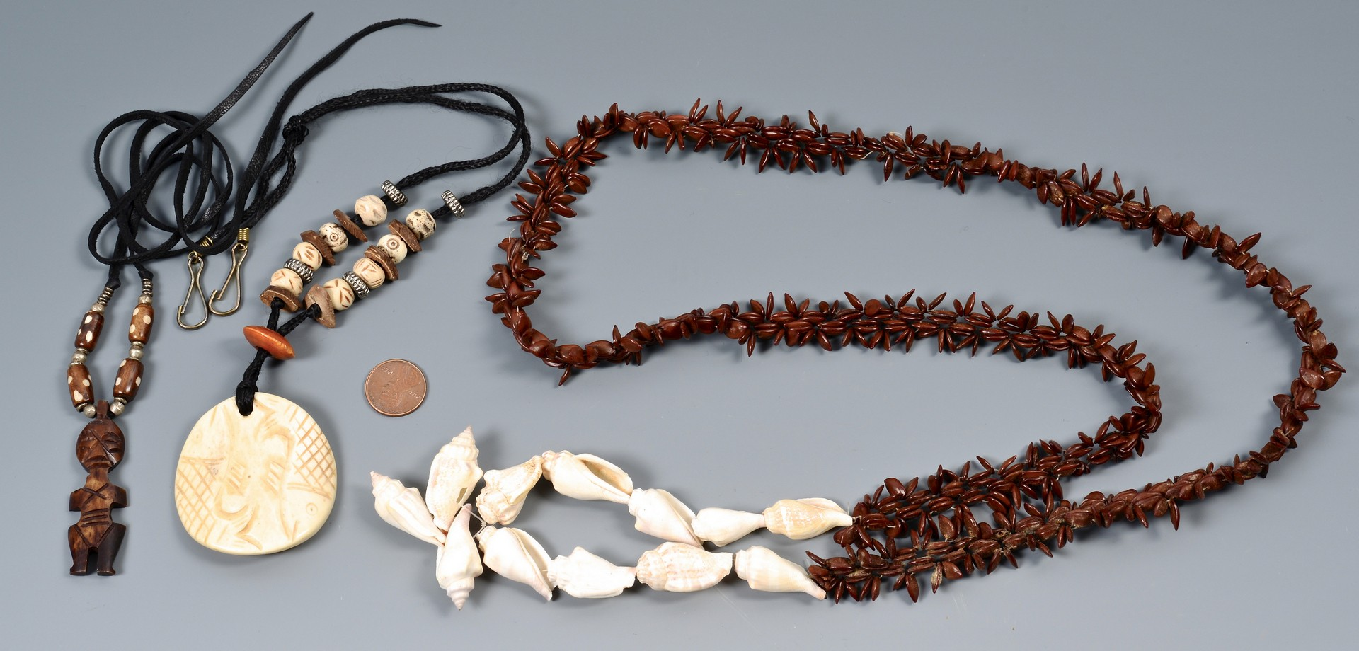 Lot 954: Group of 4 Carved Ethnic Necklaces