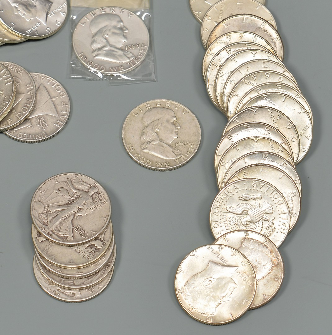 Lot 962: Sixteen 1964 Uncirculated Kennedy Half Dollars