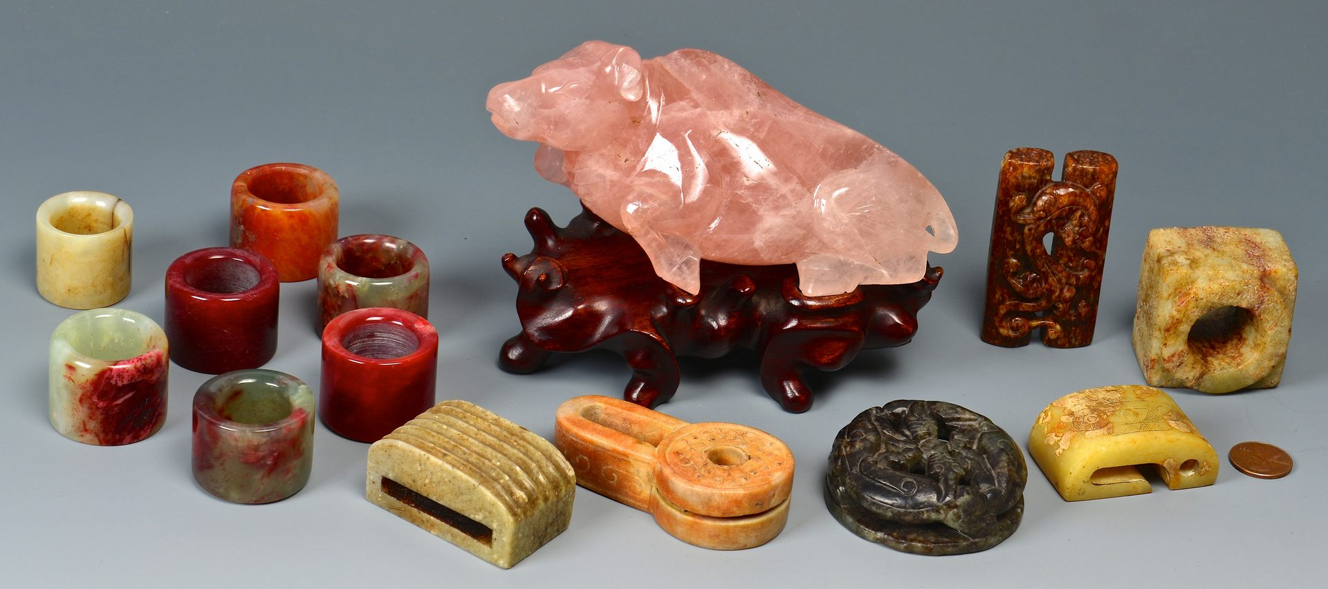 Lot 116: Chinese archer rings, cow & other hardstone items