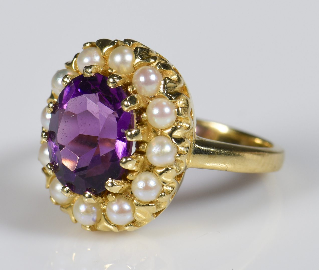 Lot 139: 14K Amethyst and pearl lady's ring