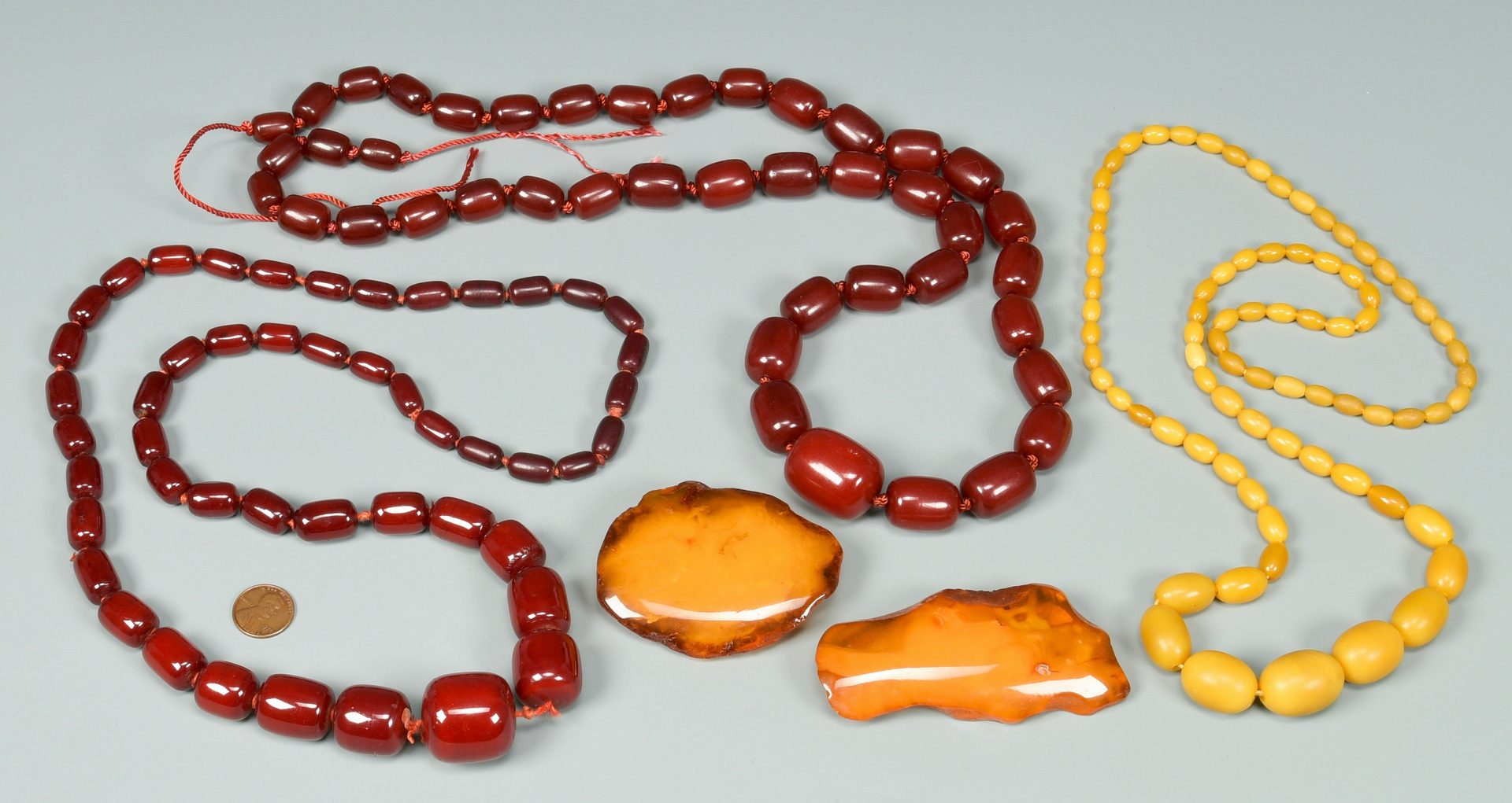 Lot 146: Grouping of Amber type jewelry