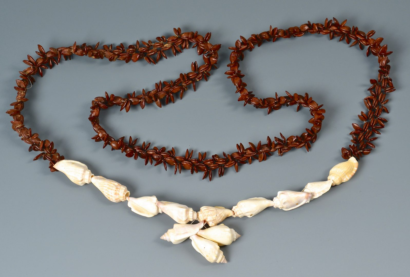 Lot 147: Group of 4 Carved Ethnic Necklaces