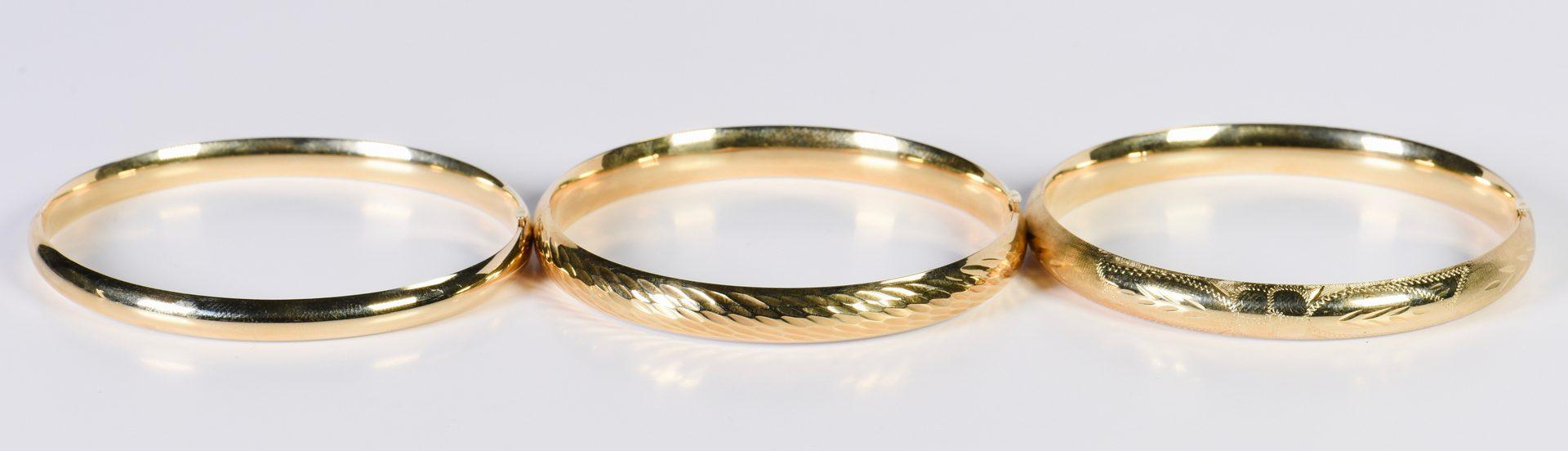 Lot 14: Group of 3 14K Bangle Bracelets
