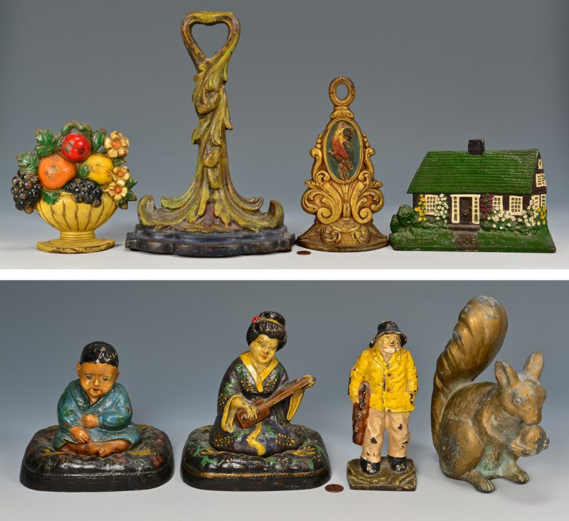 Lot 170: 7 Cast Iron Doorstops, attrib. Hubley &1 Figural