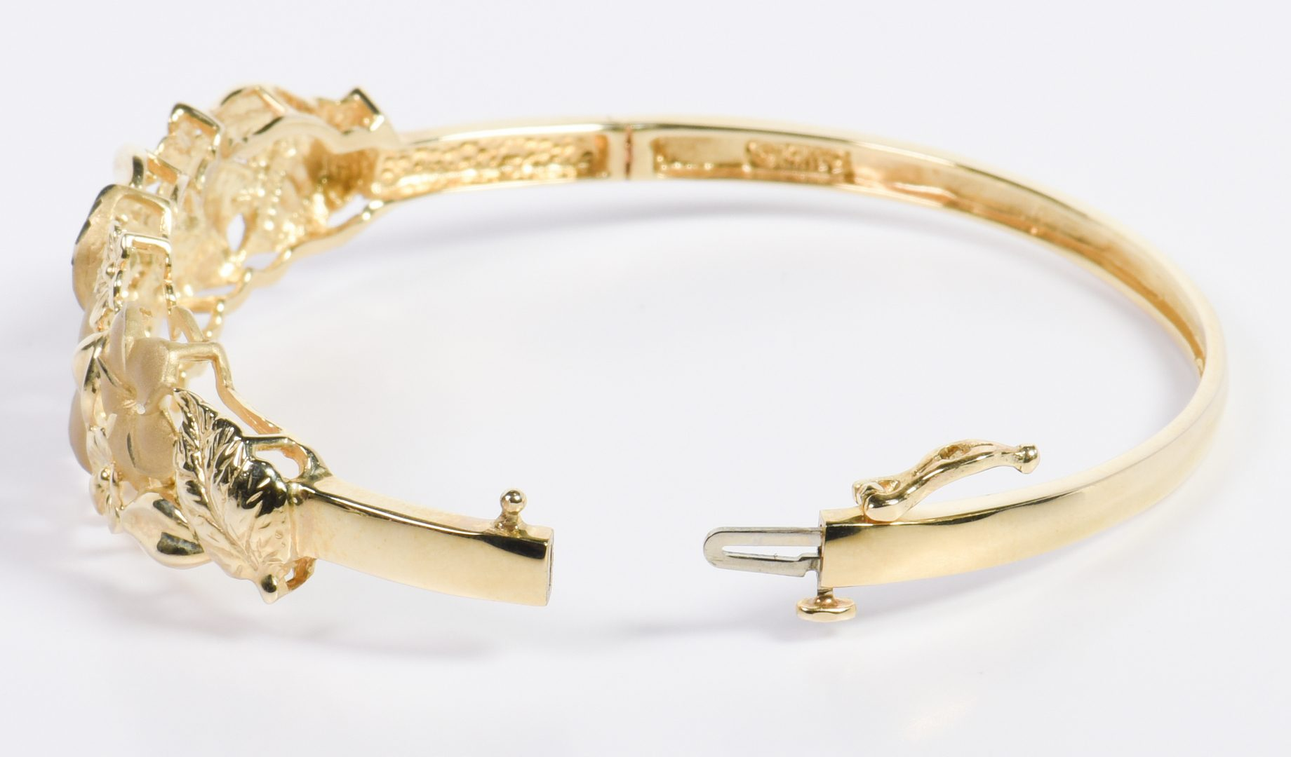 Lot 25: Two 14K Flower Theme Bracelets