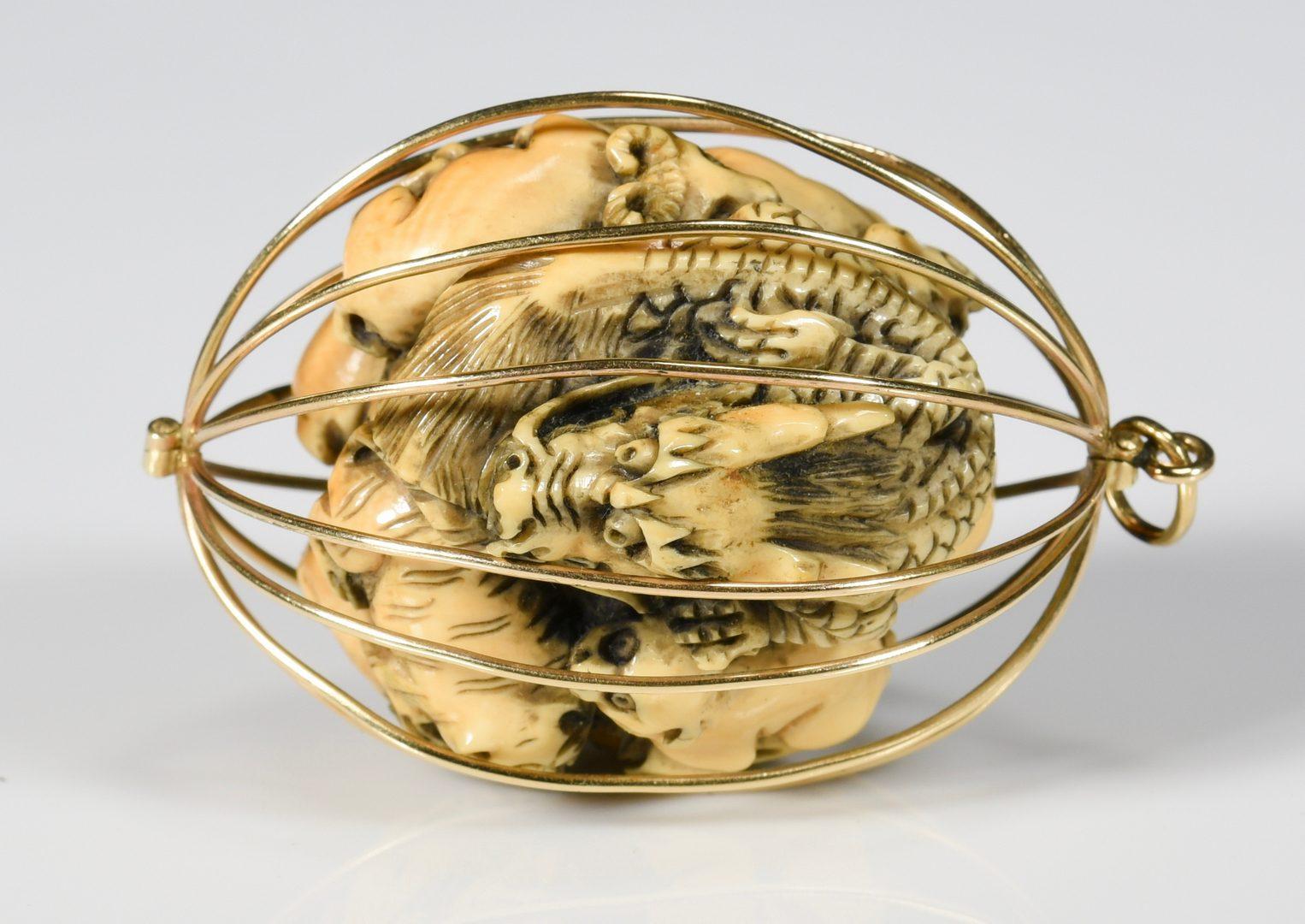 Lot 64: Carved Zodiac Netsuke, 14K cage pendant