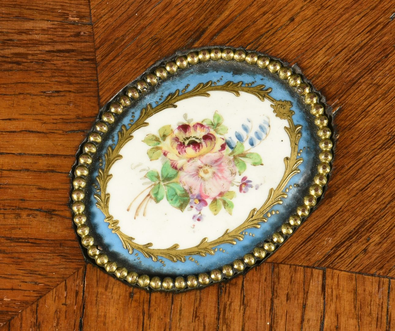 Lot 107: French Table with Porcelain Plaques