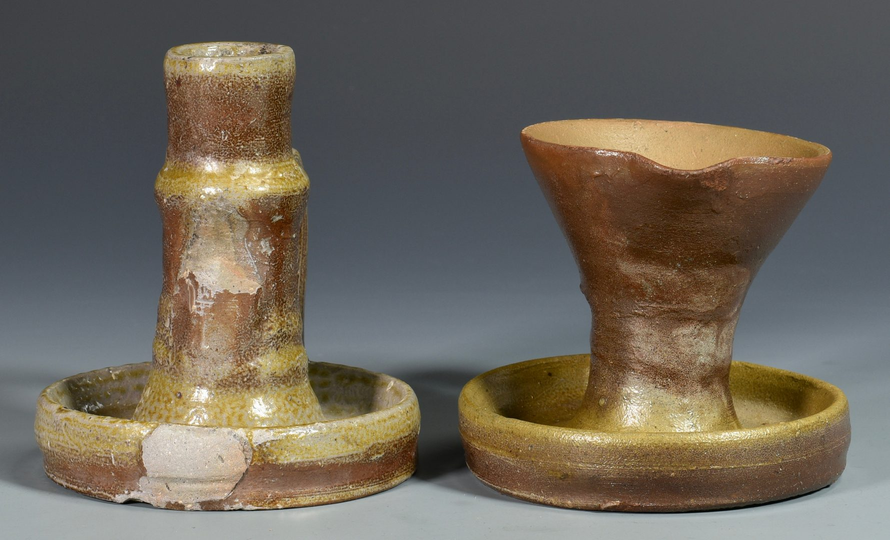 Lot 130: Middle TN Pottery Grease Lamp & Candlestick