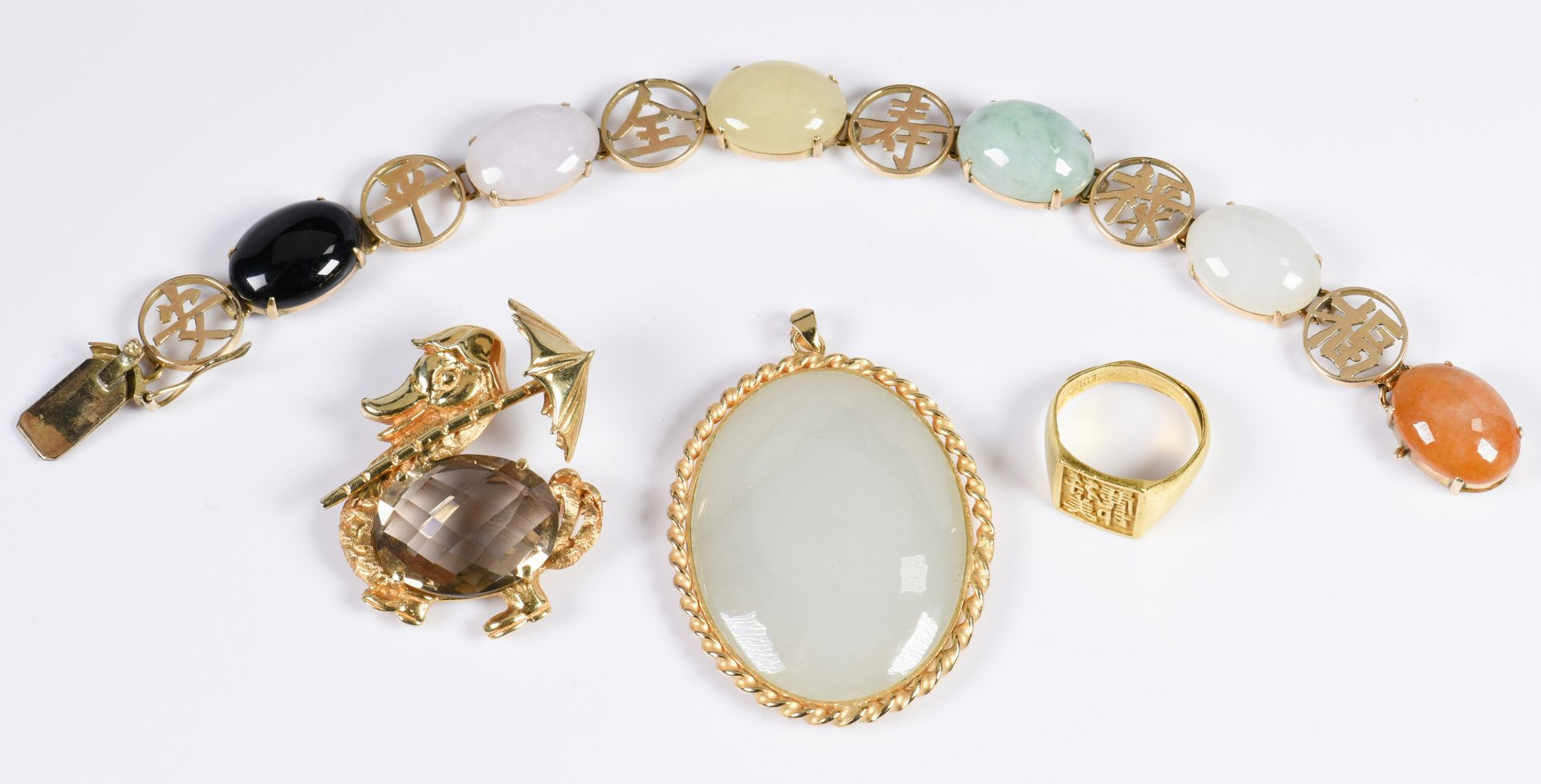 Lot 323: 4 Asian Style Gold Jewelry Items
