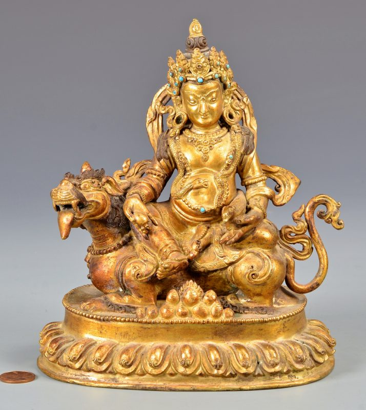 Lot 328: Sino-Tibetan Gilt Bronze Deity on Lion