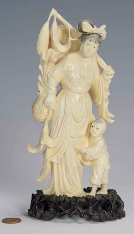 Lot 336: Ivory okimono, woman and child
