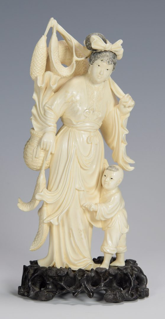 Lot 336: Ivory okimono, woman and child