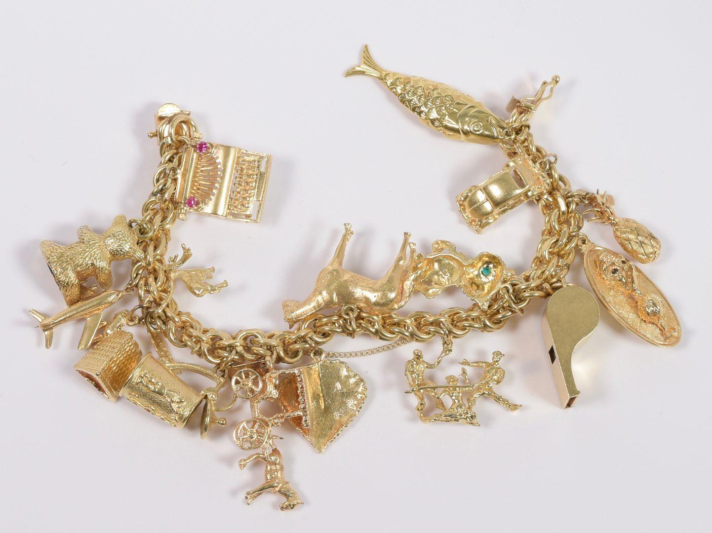 Lot 396: 14K Charm Bracelet, 16 charms, 131 grams