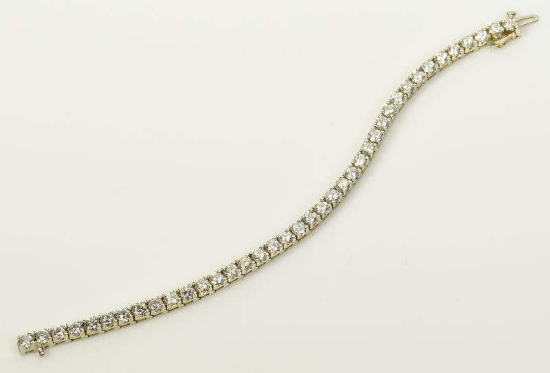 Lot 397: 14K Diamond Line Bracelet, 39 diamonds