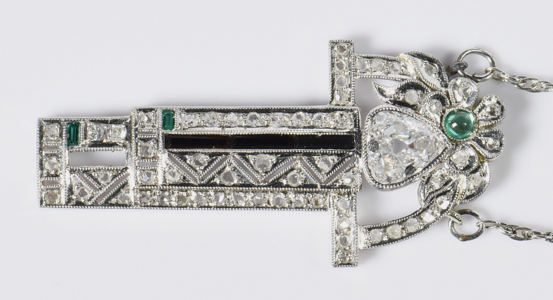 Lot 399: Platinum Art Deco Pear Diamond Pendant