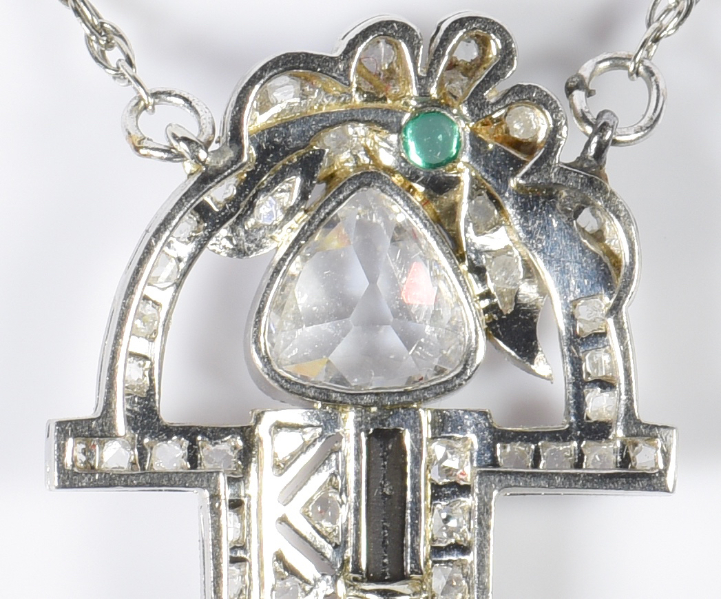 Lot 399: Platinum Art Deco Pear Diamond Pendant