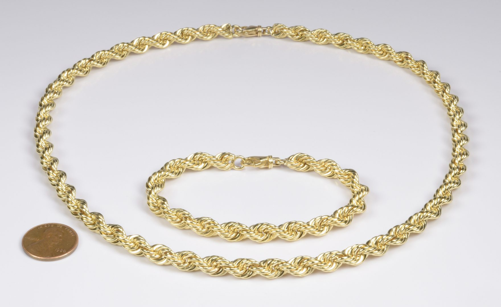 Lot 407: 14K Rope Necklace and Bracelet Set, 110 g