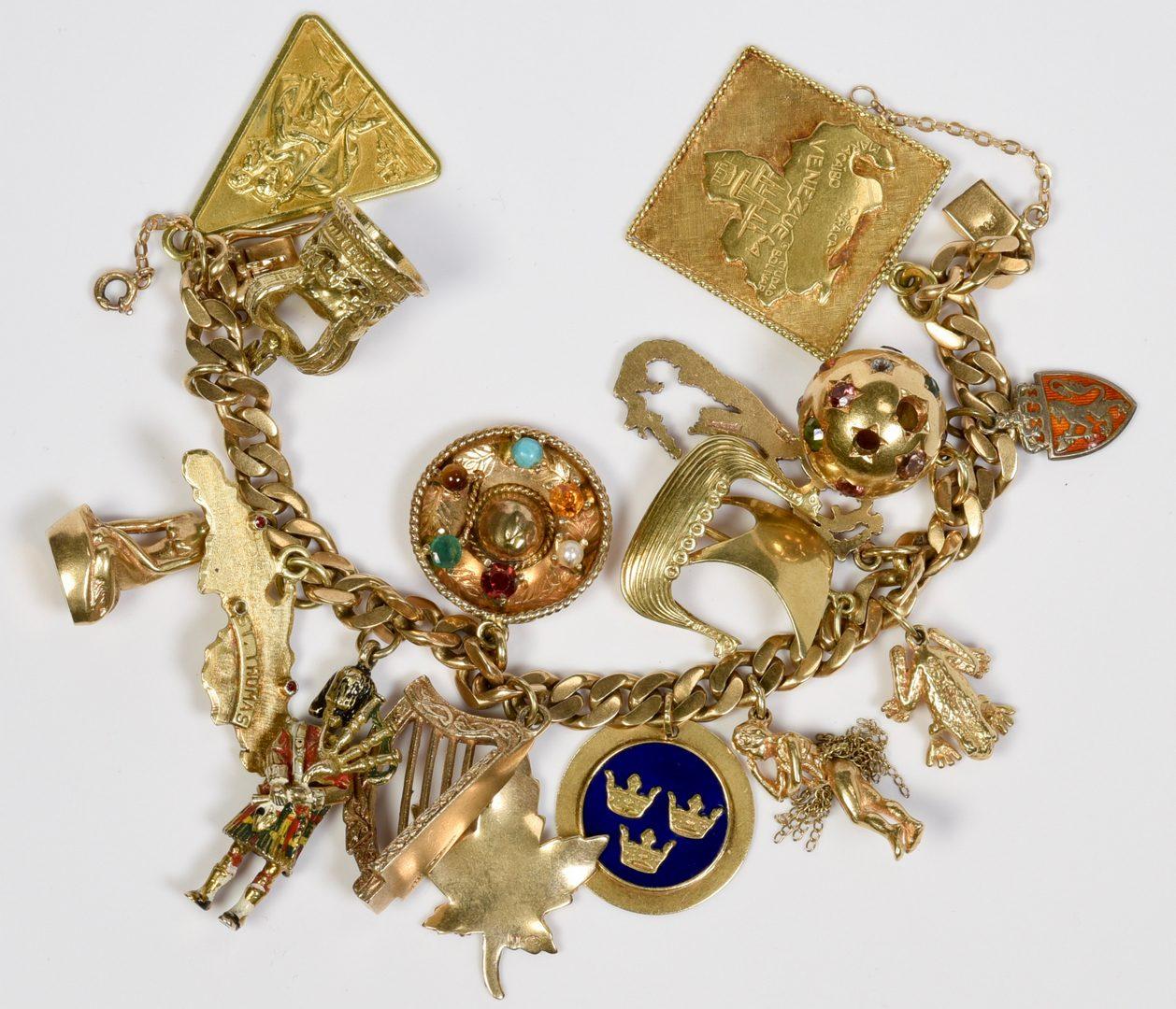 Lot 408: 14K Charm Bracelet, 88.2 grams, 16 charms
