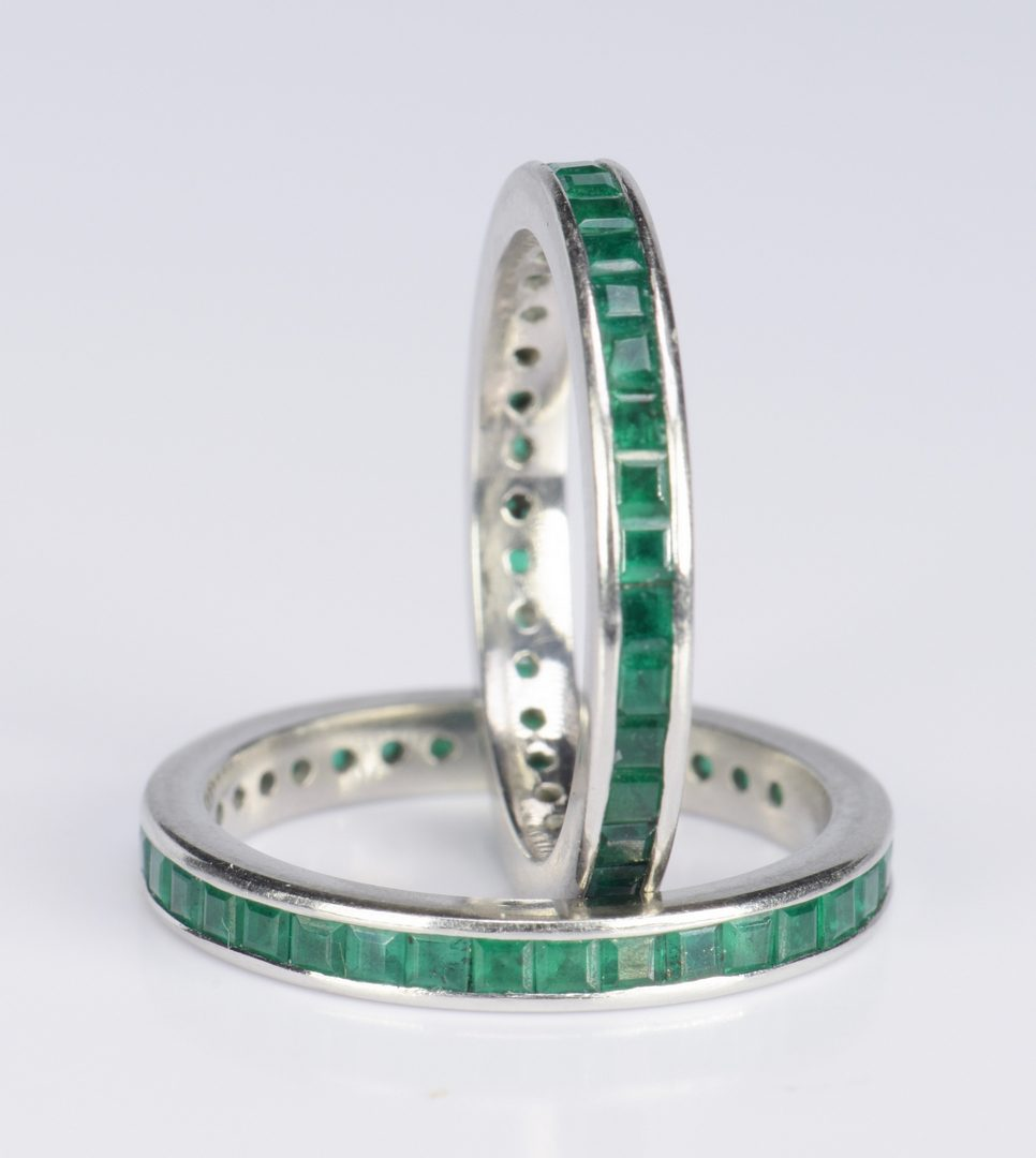 Lot 416: Pair Emerald and Platinum Eternity Rings