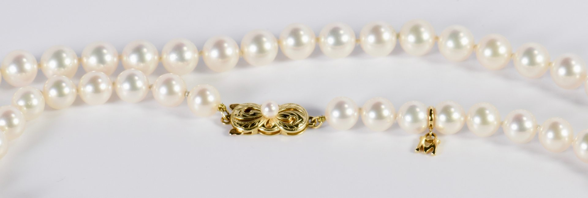 "Lot 419: 32"" strand Mikimoto Pearls"