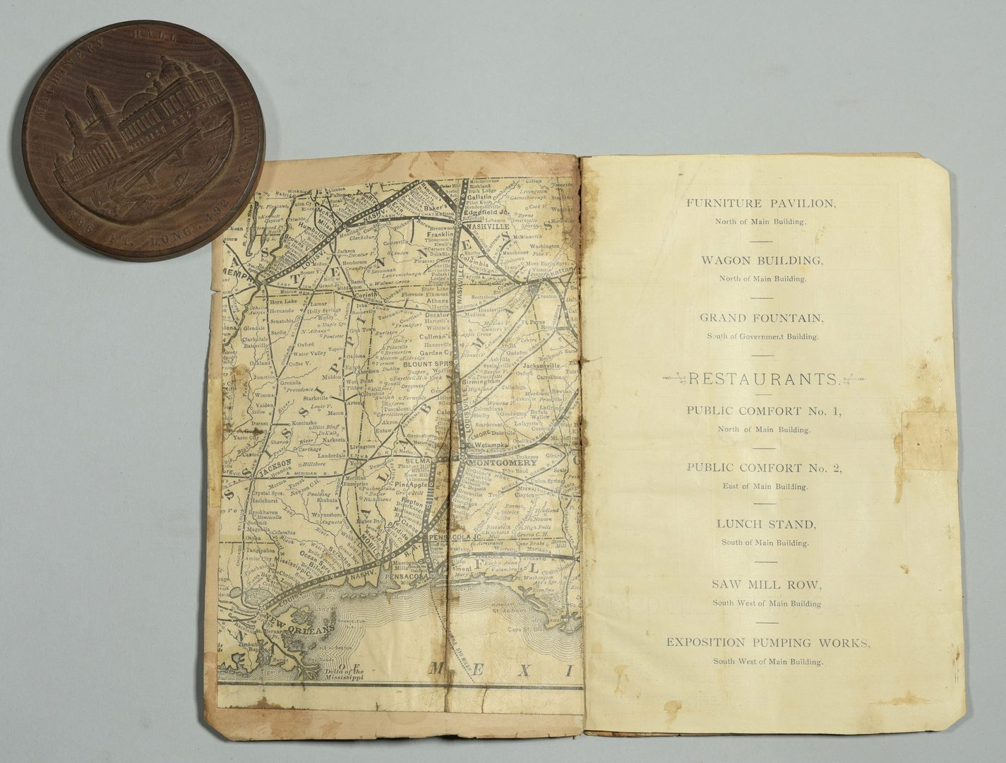 Lot 750: World Fair items inc. New Orleans Map