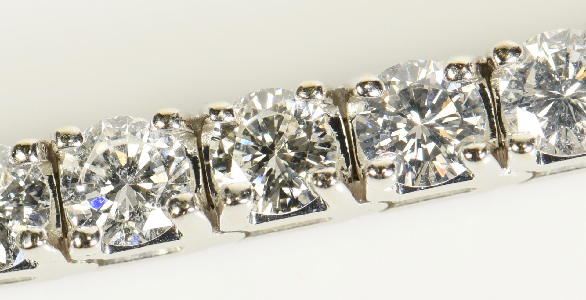 Lot 75: 14K Diamond Line Bracelet, 42 diamonds
