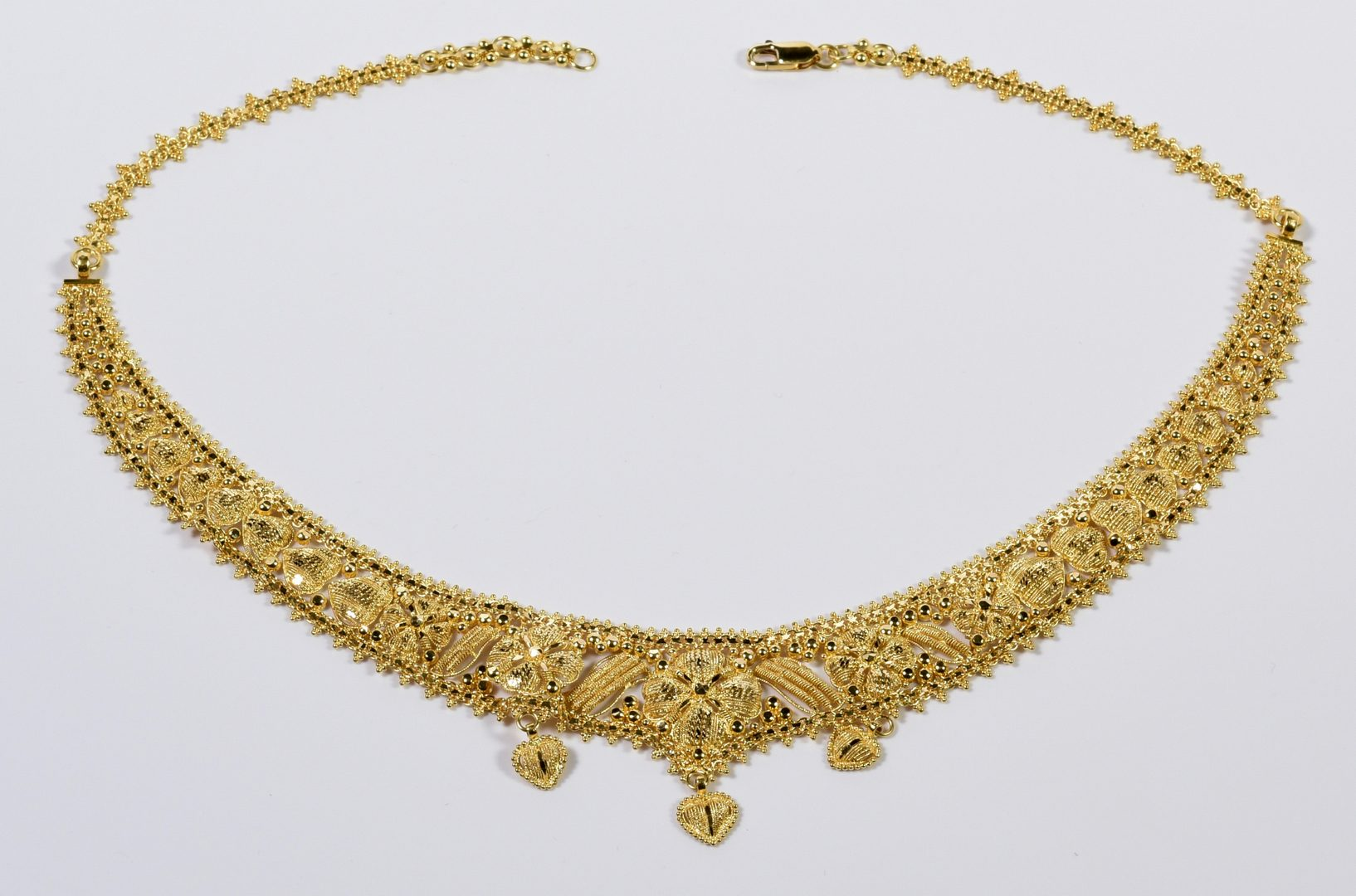 Lot 777: 21K Gold Bib Necklace and Earrings