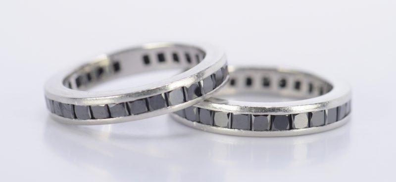 Lot 795: Pair Platinum Black Diamond Eternity Rings