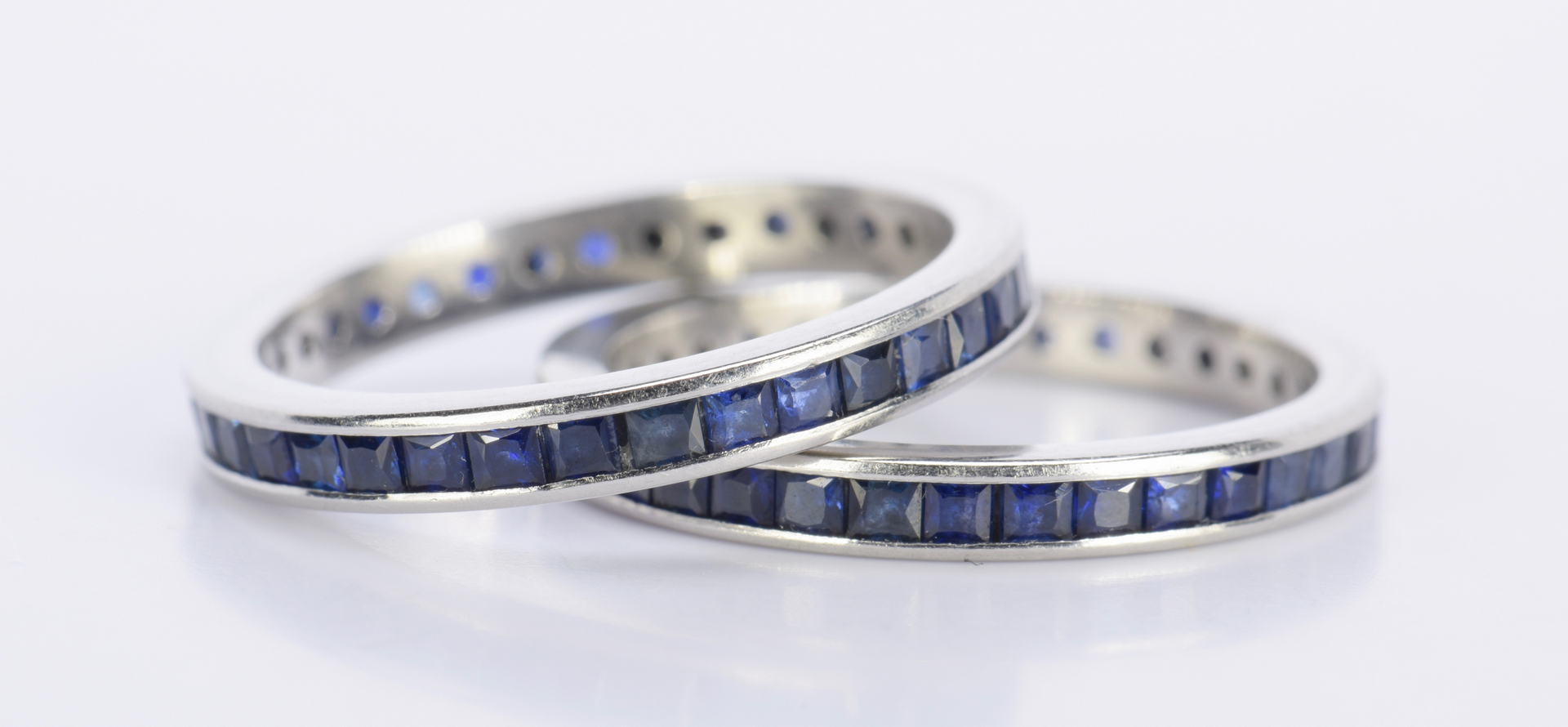 lot 804 pair sapphire and platinum eternity rings
