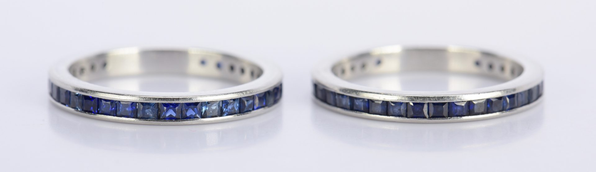 Lot 804: Pair Sapphire and Platinum Eternity Rings