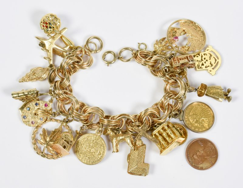Lot 80: Charm Bracelet, 22 gold charms