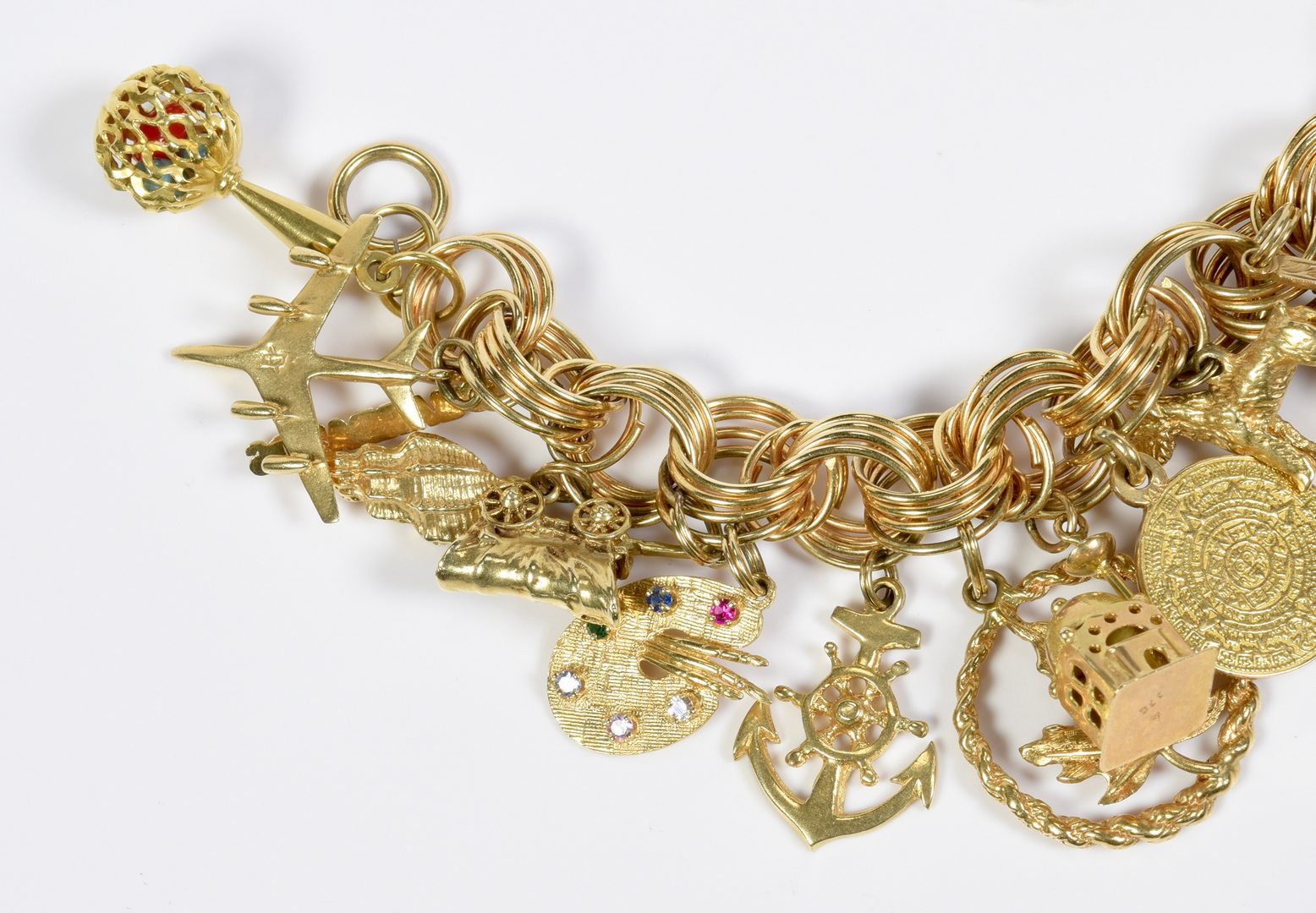 Lot 80: Charm Bracelet, 22  gold charms