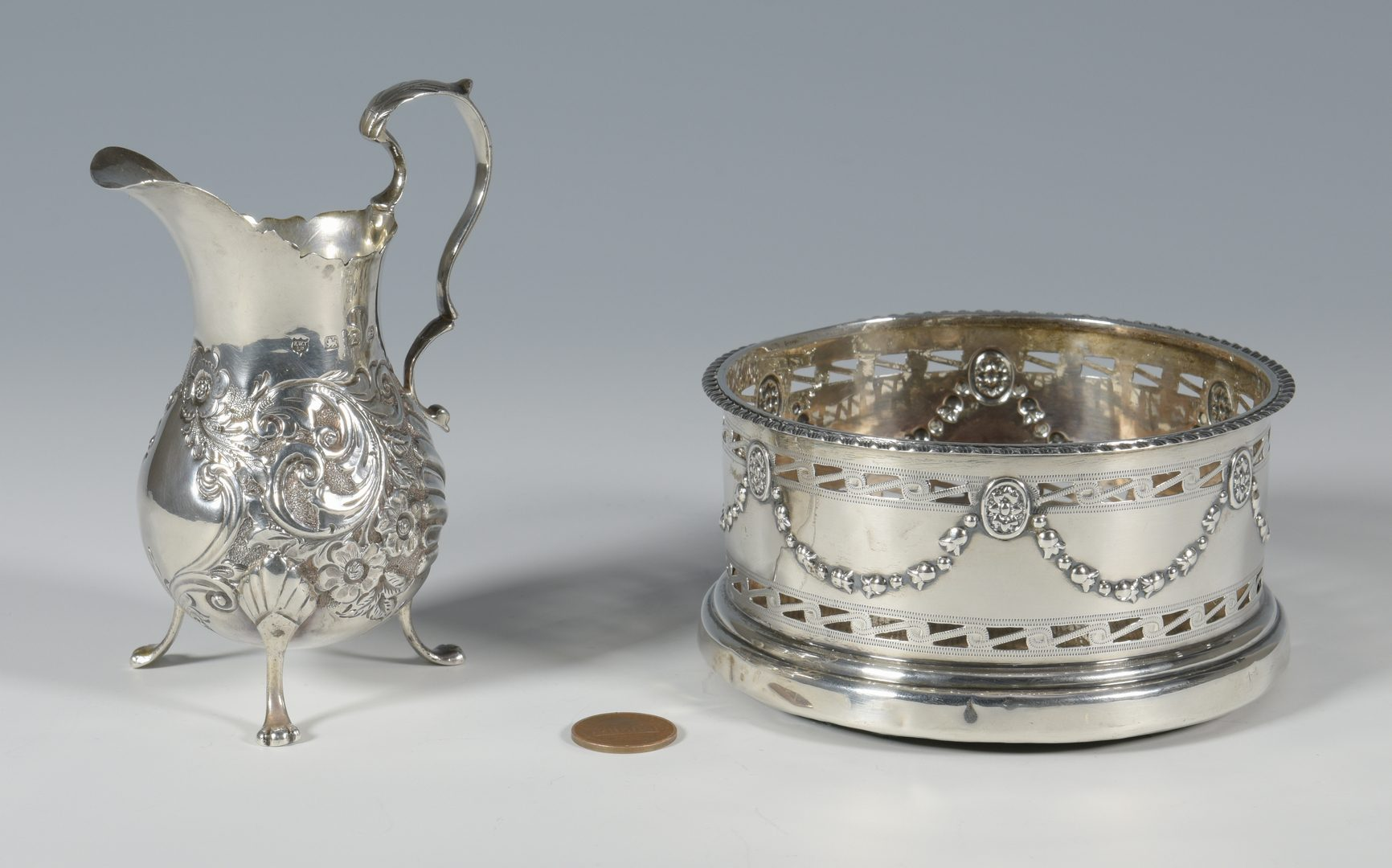 Lot 859: Sterling wine coaster and cream jug