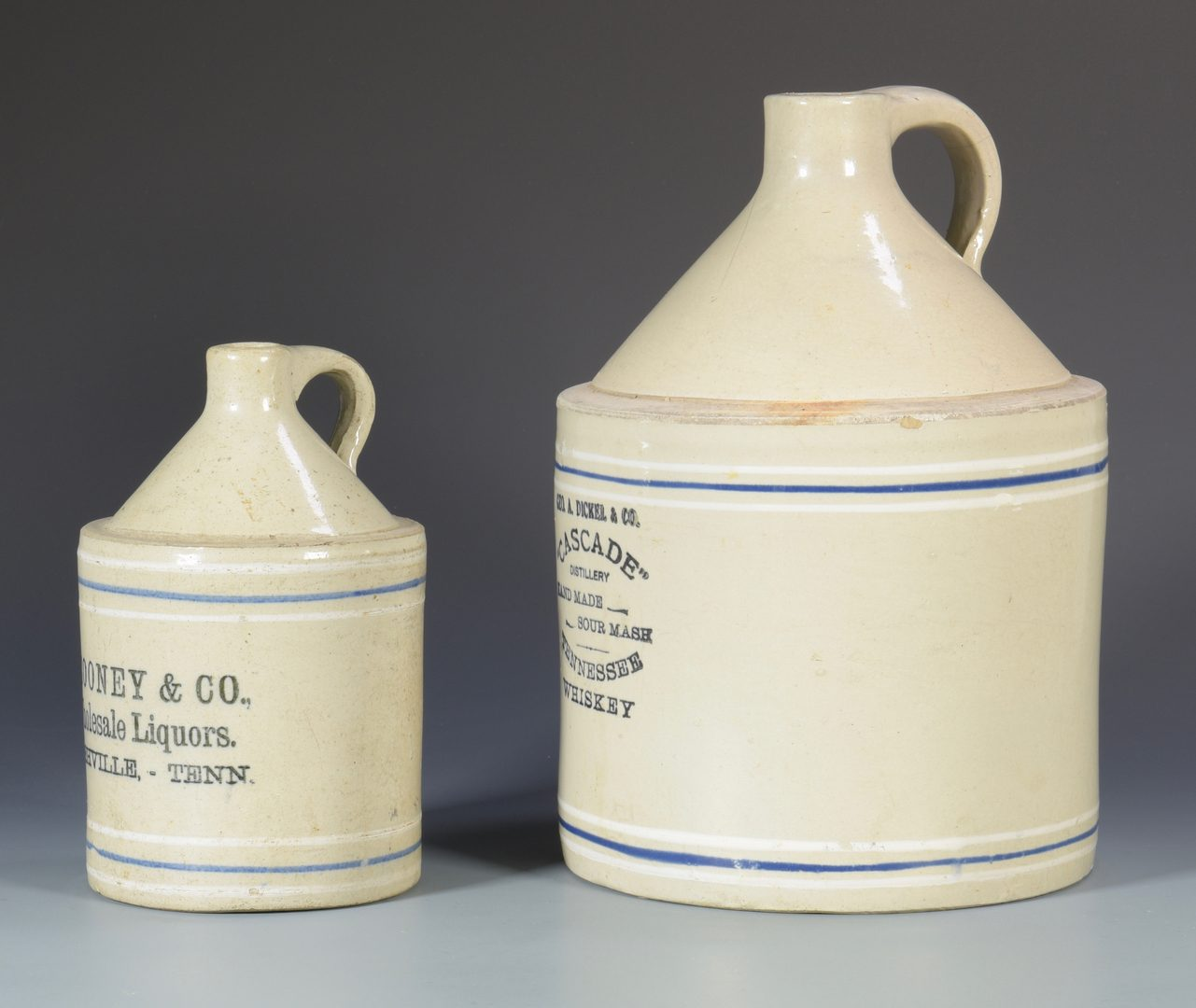Lot 934: 2 Middle TN Stoneware Advertising Whiskey Jugs