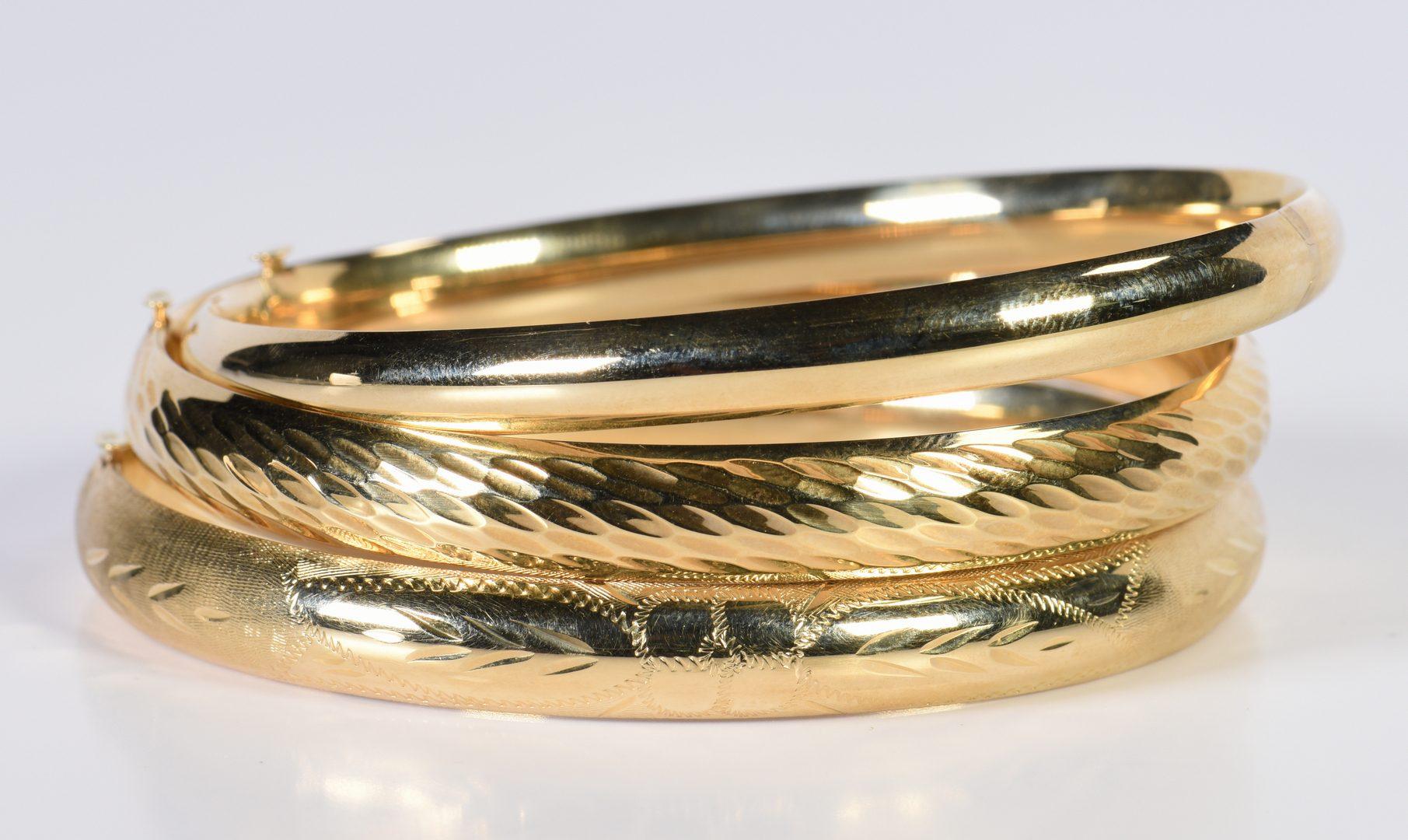 Lot 944: Three 14K Bangle Bracelets
