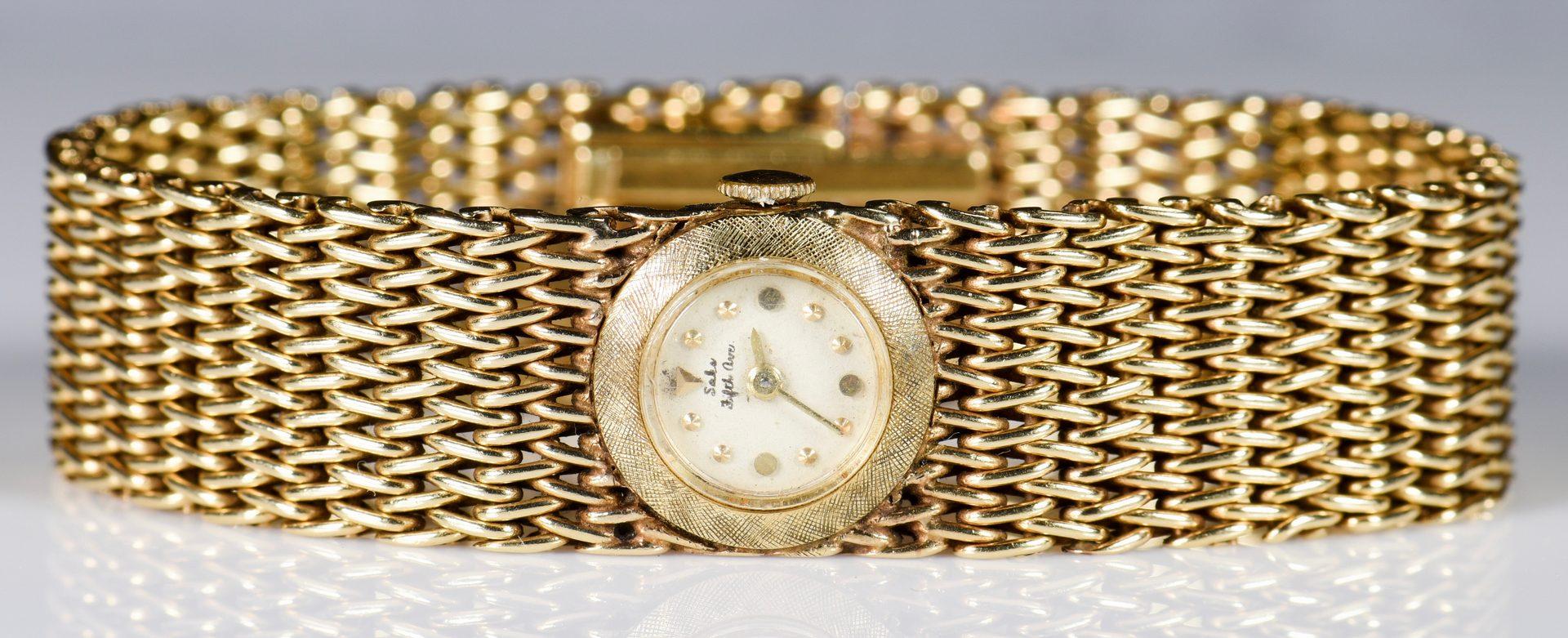 Lot 948: 14K Bracelet Watch, Saks